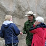 A ranger talks to visitors on the Valley of Ten Thousand Smokes Tour