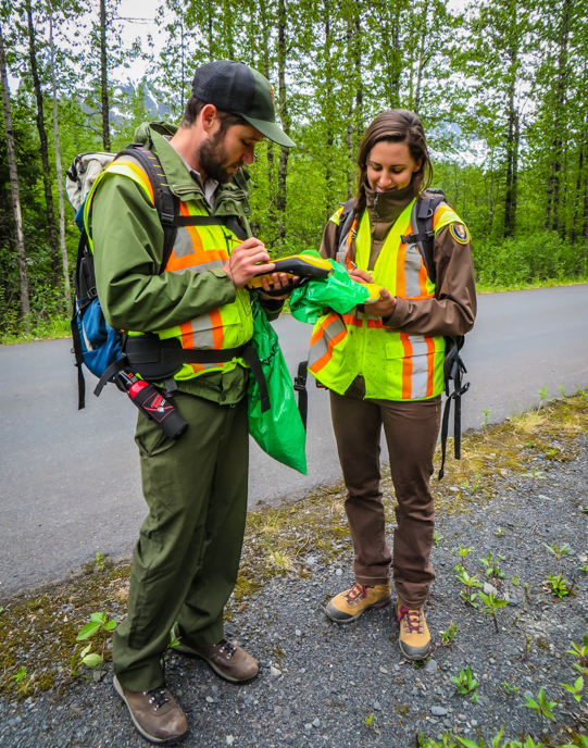Exotic Plant Management Team members use a GPS to map the location of invasive species.
