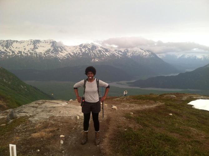 Image of SCA intern standing at the end of the Harding Icefield.