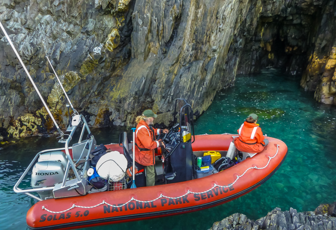 Mapping caves often requires maneuvering boats in narrow places, such as this cove in Aialik Bay. Photo K. Kurtz/NPS