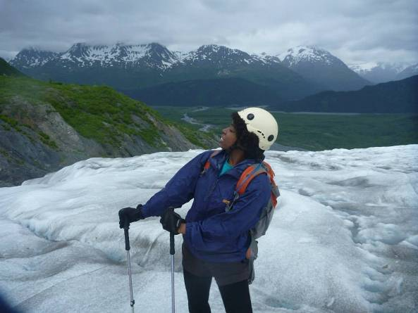 The author, standing on a glacier, dressed to in ice climbing gear.