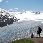 Hikers overlook Exit Glacier at the Top of the Cliffs along the Harding Icefield Trail