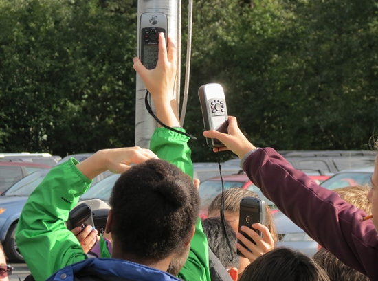 Students at the local elementary school learn to take a GPS waypoint.