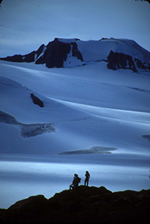 Hikers at the edge of the vast Harding Icefield