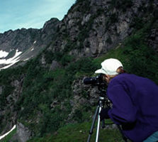 Photographer capturing a view of the fjords
