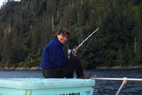 Visitor fishing in Kenai Fjords