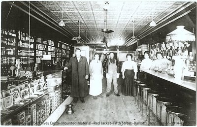 Five people pose for a photograph in a store.