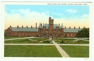A large building with a sunken garden in the foreground depicted on a postcard.