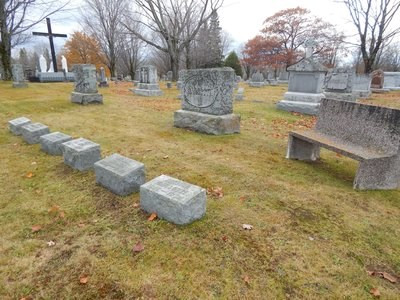 A collection of grave markers in a cemetery.