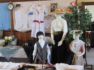 Mannequins with early 20th century clothing on.