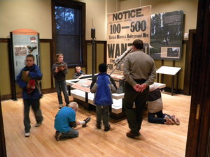 A ranger assists students exploring exhibits inside the Calumet Visitor Center.