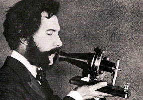 1876 photograph of Alexander Graham Bell speaking into telephone