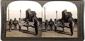 Historic Photo: A stereoview of a Calumet & Hecla rescue crew near a shafthouse, circa 1910.