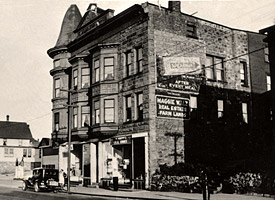 Photo of the Maggie Walz Block on 6th Street in Calumet, circa 1942.