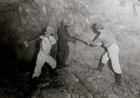 Historic photo: This 1875 photograph shows a team of three miners drills holes in the rock by hand.