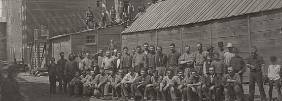 Historic photo: Mine workers pose outside the Hecla Mining Company