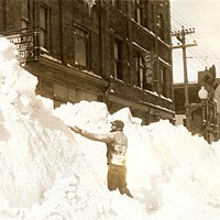 Historic Photo: Man shoveling snow on Hecla Street in Laurium in 1933.