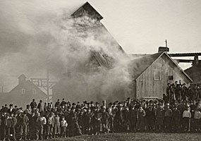 Historic photo: Smoke billows out of the Osceola #3 shaft while workers and area residents pose for this 1895 photograph.