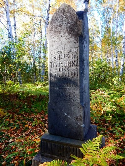 A grave marker in the forest.