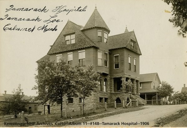 A three-story Queen-Anne style hospital building.