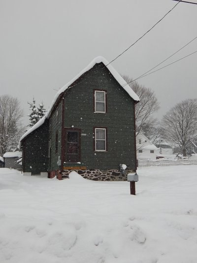 A house with snow falling.