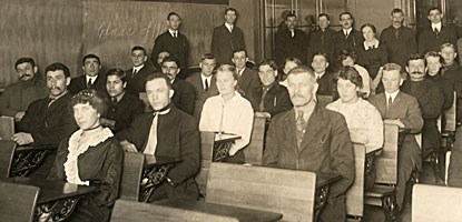 A night class is conducted for immigrants to the Copper Country in the early 1900s.