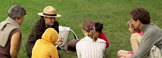 A park ranger helps kids learn about the different types and uses of copper.