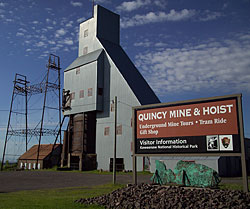 The sign for the Keweenaw National Park Information Desk at the Quincy Mine illustrates how the park works in partnership with many entities.