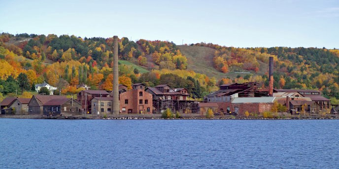 The Quincy Smelter surrounded by autumnal trees.