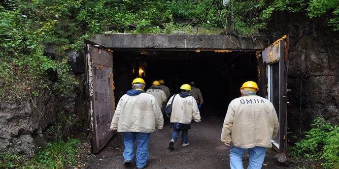 Visitors with hard hats enter the Quincy Mine, one of the Keweenaw Heritage Sites.