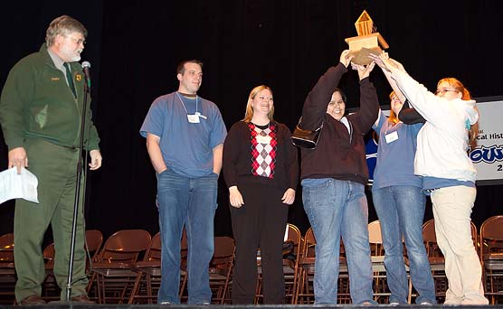 Winning team members Jessica Budreau, Ashley Shalifoe, and Denise Swift hoist the Smackdown Trophy.