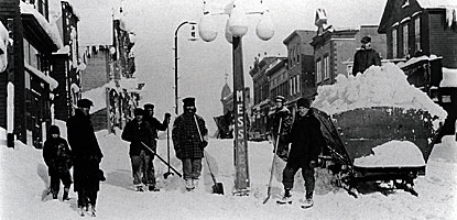 Historic photo of snow removal in Calumet near the corner of Elm and 5th Streets in 1900.