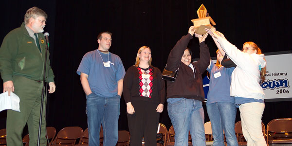 The Baraga Boondocks, winners of the 2006 Smackdown, hoist the trophy during the awards ceremony.