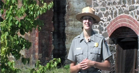 photo: Ranger Kristen Schmitt outside Quincy Mine's #2 Shaft-rockhouse.