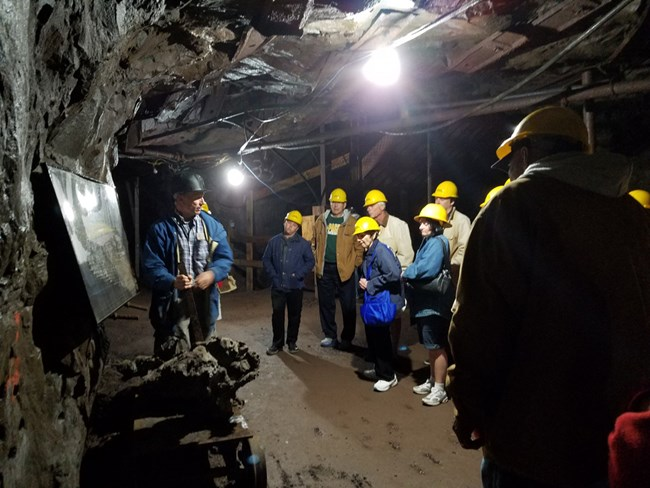 Visitors tour the Quincy Mine underground.