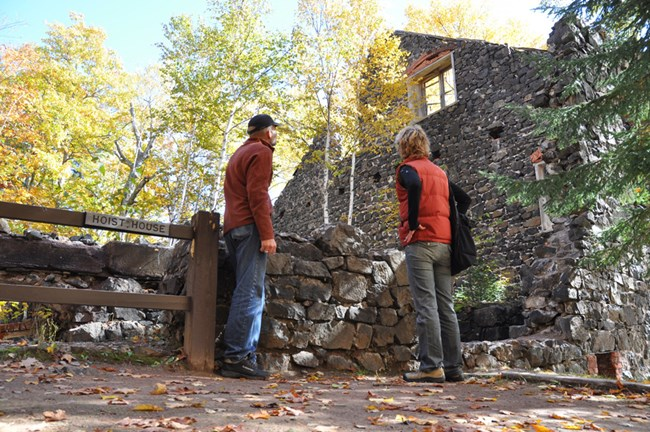 Visitors explore the Delaware Mine ruins.