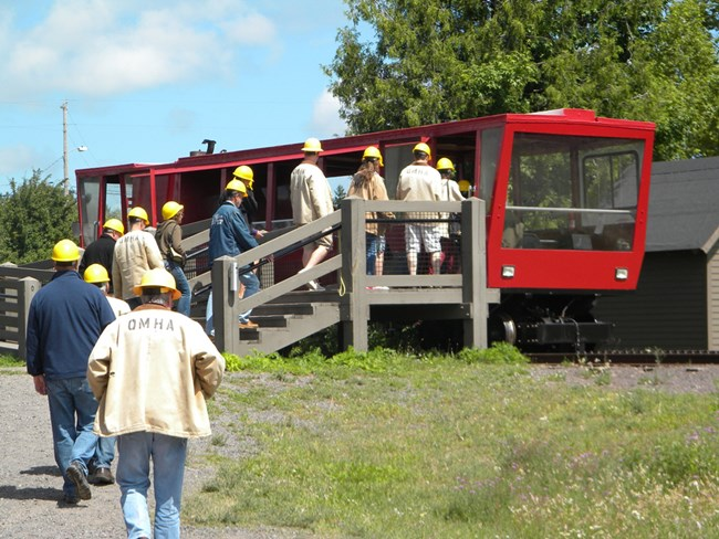 Visitors prepare to travel down the hill on the Quincy tram.