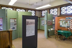 Different exhibits are displayed on panels inside the Carnegie Museum.