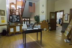 A diverse collection of items on display inside the Chassell Heritage Center.