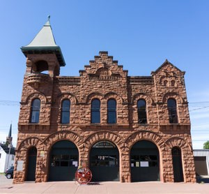 The exterior sandstone structure of the Copper Country Firefighters History Museum.