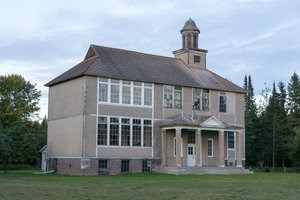 The gray exterior of the Gay Schoolhouse.