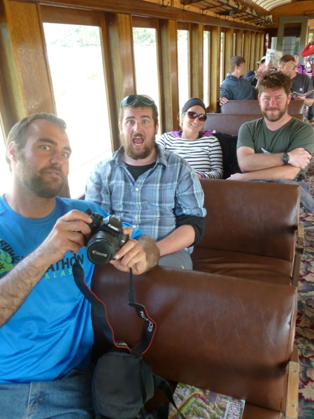 [Photo 3] Tom, Phil, Nicole, and Shawn on the train after completing the Chilkoot Trail