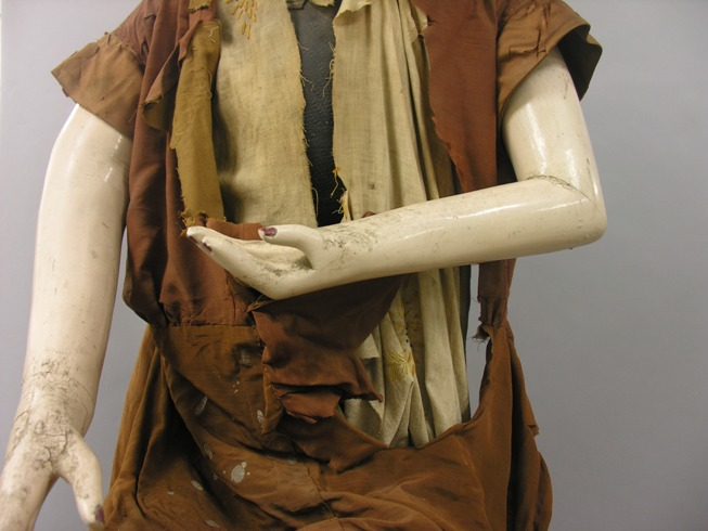 Lady Lou's torso, before treatment, showing shattered silk sleeves
