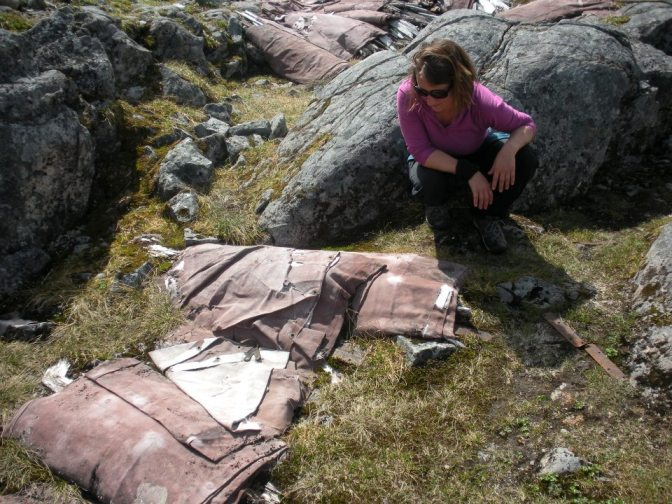 [Photo 8] Nicole assessing the condition of the collapsible boats near the Summit