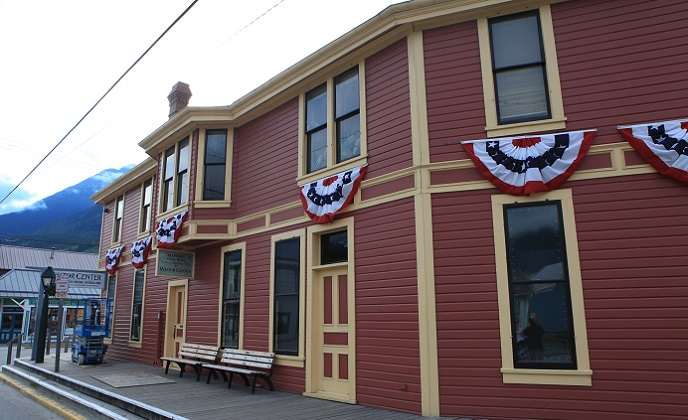 Historic depot building with patriotic bunting