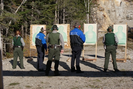 Law Enforcement personnel shooting guns