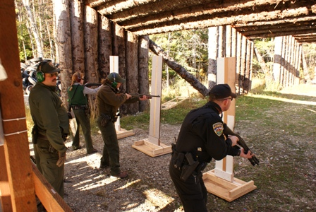 Law Enforcement Personnel shooting shotguns