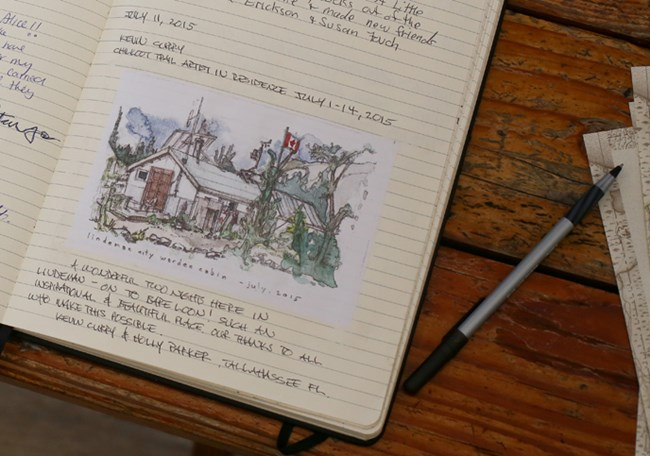 Close up of trail journal with water color illustration