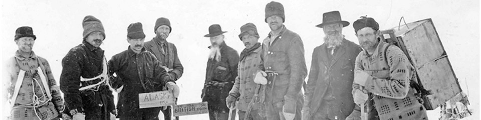historic photo of men with gear at the Alaska-British Columbia border in the snow