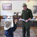 Ranger awards a badge to a new Junior Ranger